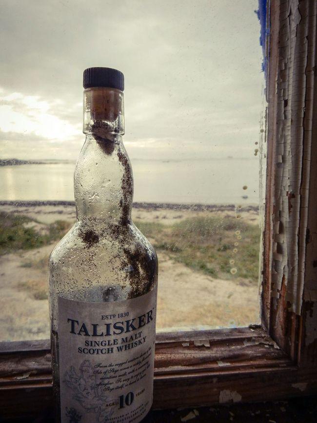 Talisker Talisker Distillery Bottle Alcohol Bottles Window View Beach Sea Cottage Cottage Life Wiskey Whisky Single Malt Scotch Scotch Whisky Drinking Talisker Bay Talisker Bottle Neck Windows Window View Window Light Wiskey Collection Single Malt Scotch Wisky