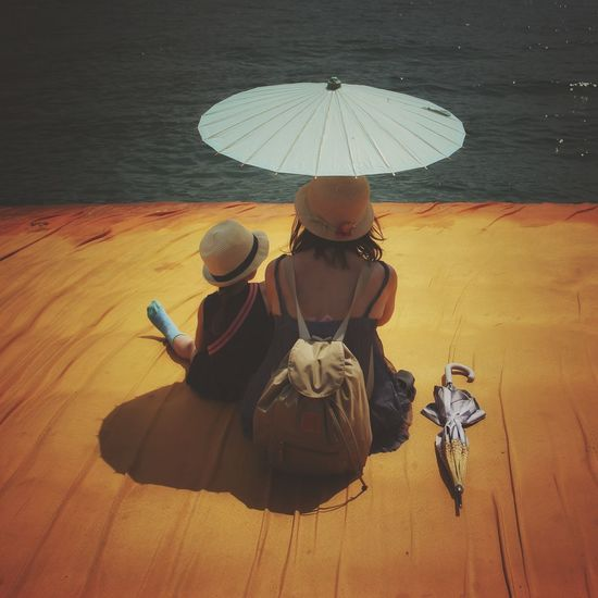 Walking on the Floating piers   Mother Fine Art Close-up Point Of View Golden Moments  Tailored To You Christo And The Floating Piers Getting Inspired Original Experiences The Essence Of Summer Still Life TK Maxx Socksie Nature People The Floating Piers Sunshine Feel The Journey The OO Mission Relaxing 43 Golden Moments Showcase July Edge Of Imagination Umbrellas Lago D'Iseo EyeEm Italy  