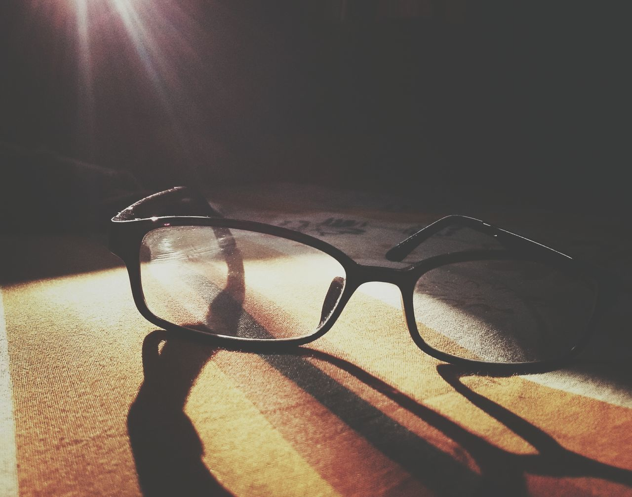 sunglasses, eyeglasses, shadow, eyewear, glasses, sunlight, eyesight, vision, table, no people, indoors, close-up, day