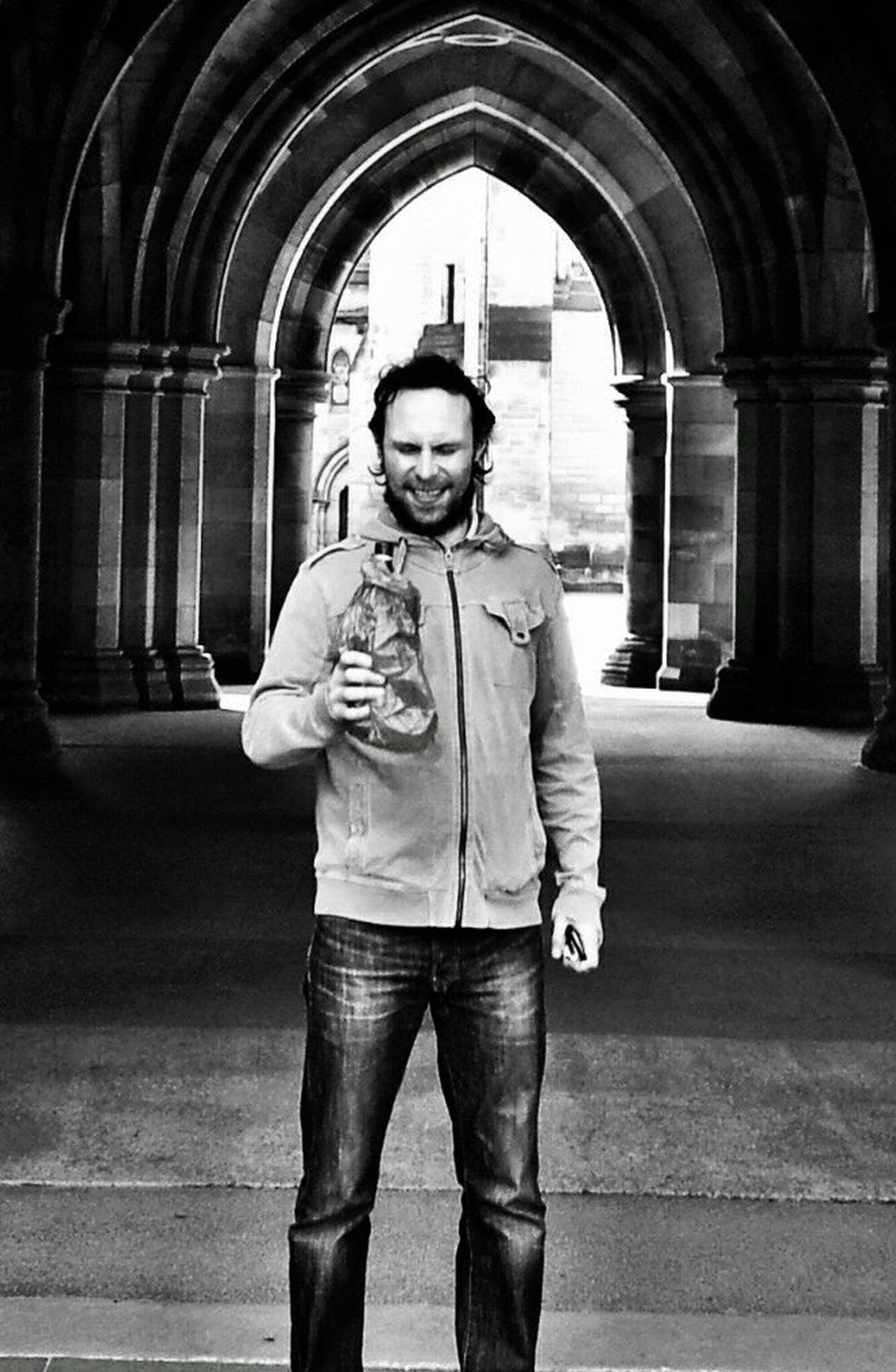 Buckfast Glasgow University Blackandwhite Brown Paper Bag Gothic Arch Daytime Drinking Portrait Of A Man