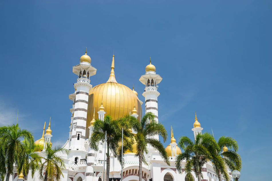 The Ubudiah Mosque is Perak's royal mosque, and is located in the royal town of Kuala Kangsar, Perak, Malaysia. Architecture Building Exterior Business Finance And Industry City Cityscape Clear Sky Cultures Day Dome Gold Colored No People Outdoors Perak Darul Ridzuan, Malaysia Pilgrimage Place Of Worship Religion Sky Travel Travel Destinations Tree Ubudiah Mosque