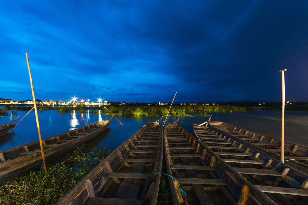 PHAYAO, THAILAND - JULY 19, 2016: The bamboo bridge, The bamboo bridge of Wat Ti Lok Aram temple in kwan phayao off freshwater lake of Thailand. Day is the important Buddhist. ASIA Bamboo Bridge Beauty In Nature Blue Buddhist Cloud - Sky Diminishing Perspective Important Jetty Kwan Phayao Long Nature Outdoors Pier Scenics Sky Street Light Temple Thailand The Way Forward Tranquil Scene Tranquility Vanishing Point Wat Ti Lok Aram Water