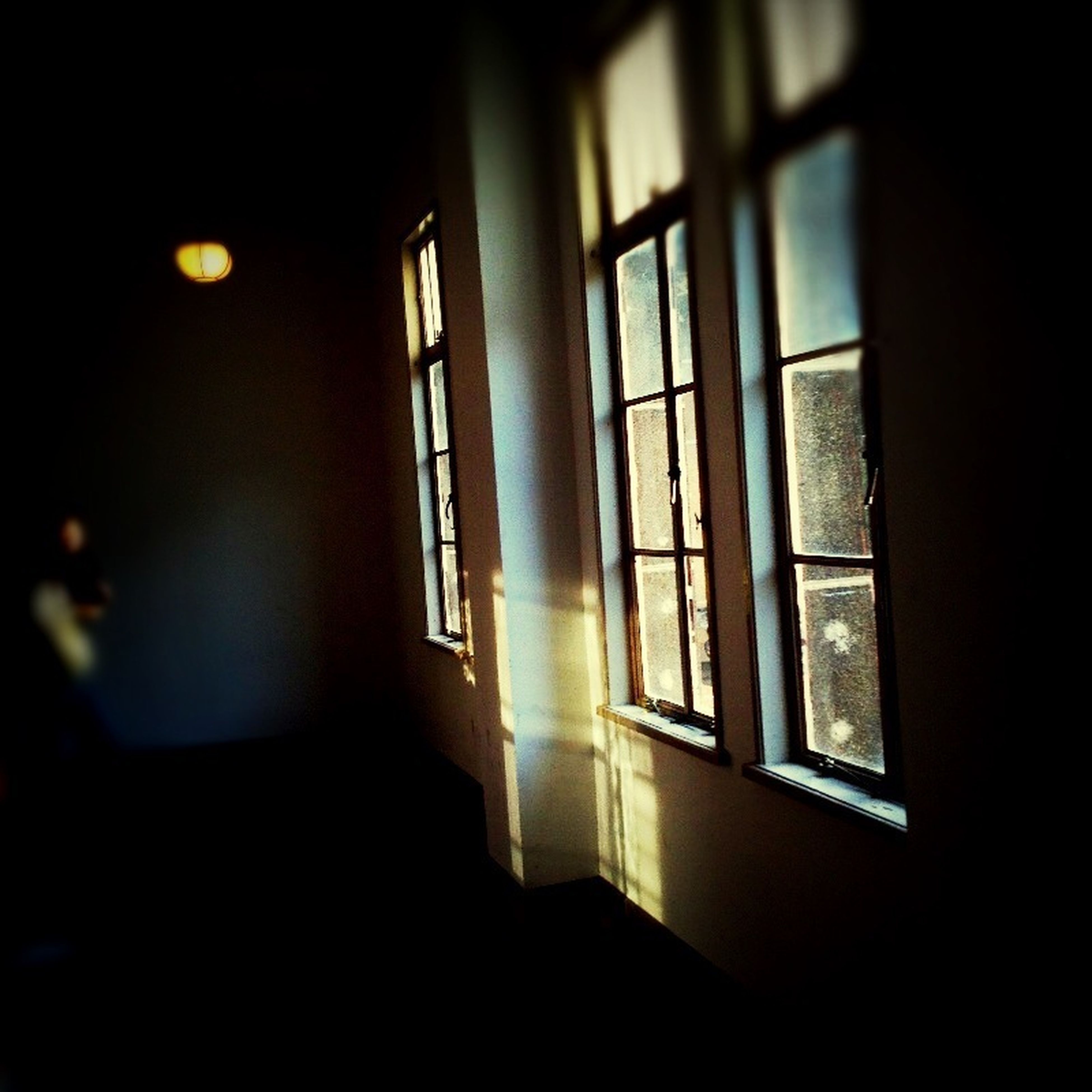 indoors, window, architecture, built structure, home interior, glass - material, dark, house, transparent, building, no people, sunlight, wall - building feature, wall, interior, day, door, empty, absence, corridor