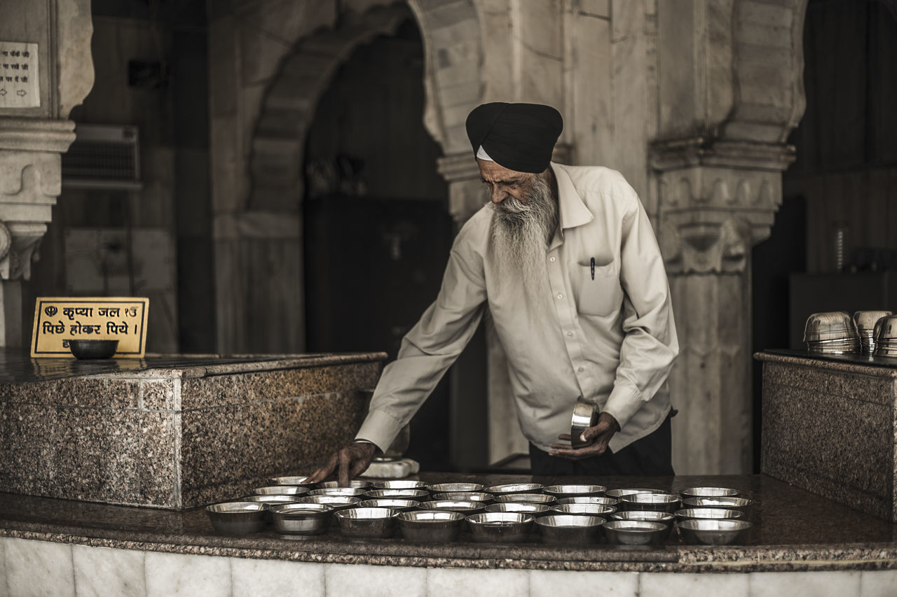 Old Sikh man pours their holy water . Adult Adults Only India Indian Indoors  Man Men Old Old-fashioned One Man Only One Person Only Men People Religion Street Streetphotography Travel Photography