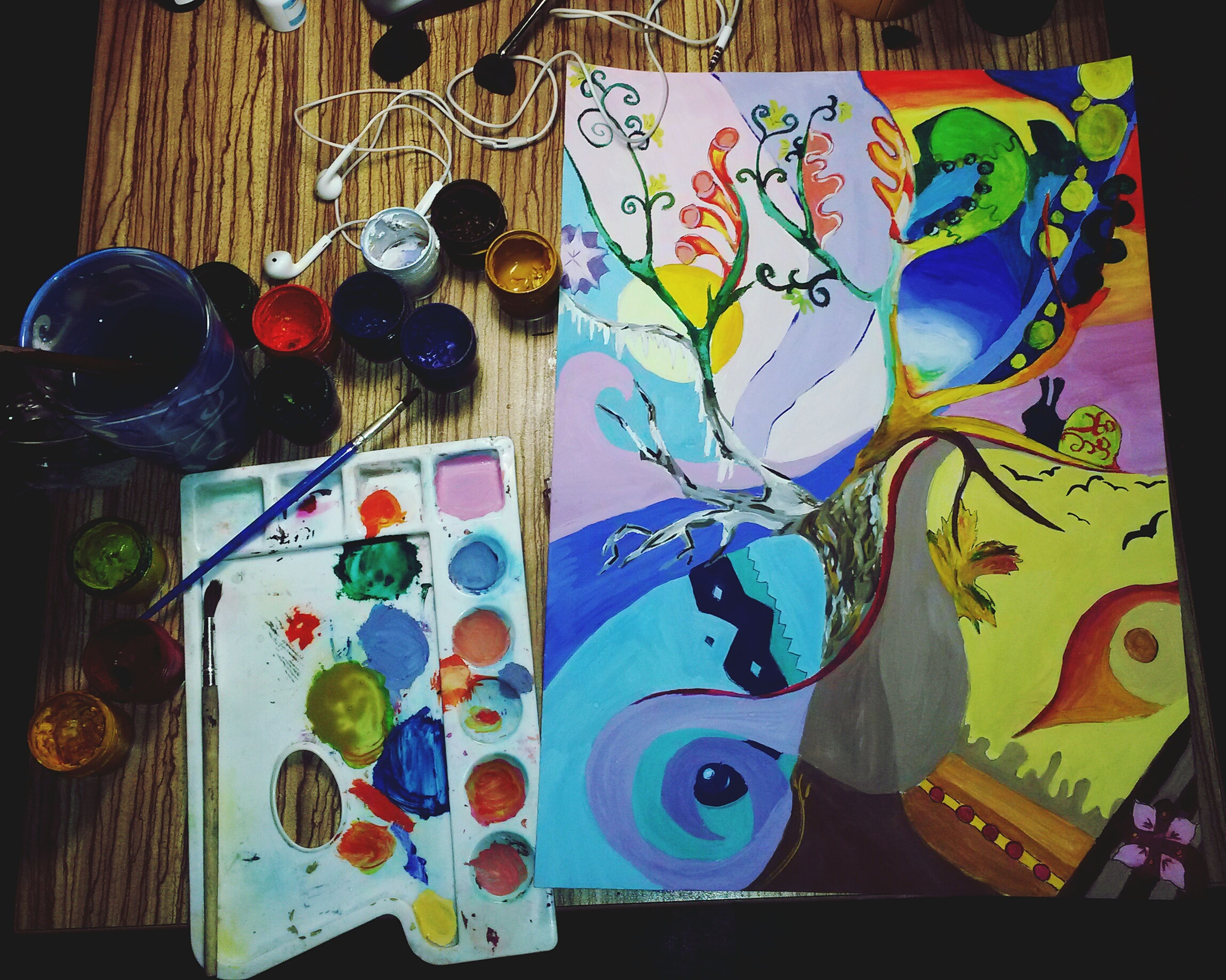indoors, multi colored, creativity, art and craft, art, still life, table, variation, colorful, animal representation, no people, human representation, wood - material, floral pattern, decoration, close-up, high angle view, craft, design, choice