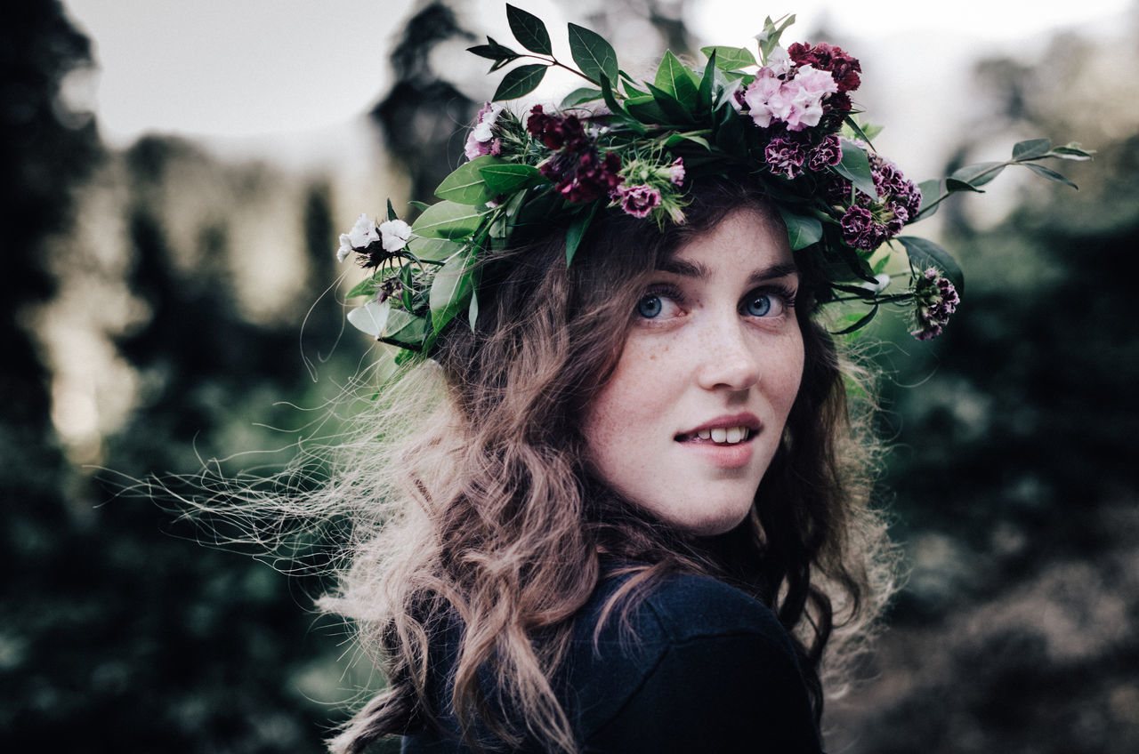 Beautiful Woman Close-up Crown Day Flower Focus On Foreground Headshot Laurel Wreath Leisure Activity Lifestyles Long Hair Looking At Camera Nature One Person Outdoors People Portrait Real People Tree Wearing Flowers Young Adult Young Women Live For The Story The Portraitist - 2017 EyeEm Awards