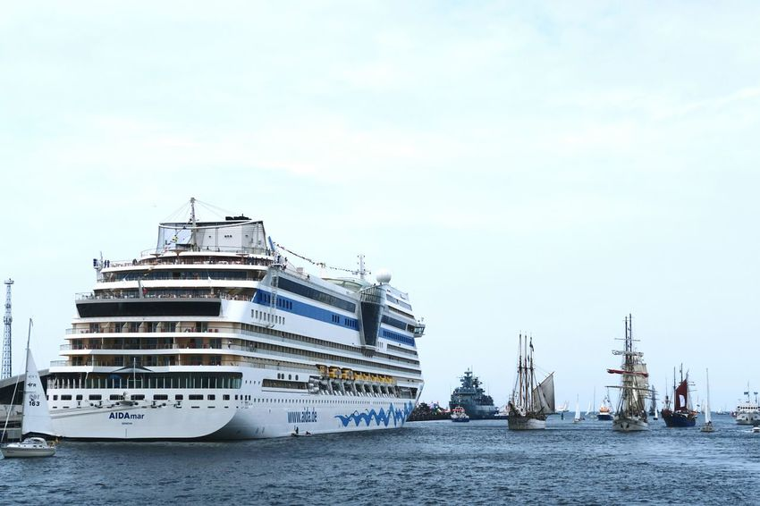 Aida Mar cruises in Warnemuende during Hansesail event. Cruising ship. Aida Aidacruises Aidamar Cruise Ship Day HanseSail Hansesail 2016 Harbor Harbor Harbor View Nautical Vessel Outdoors Rostock Rostock 2016 Rostocker Hafen Rostocker Stadthafen Sailing Sailing Boat Sailing Boats Sailing Ship Ship Sky Warnemünde Water Waterfront