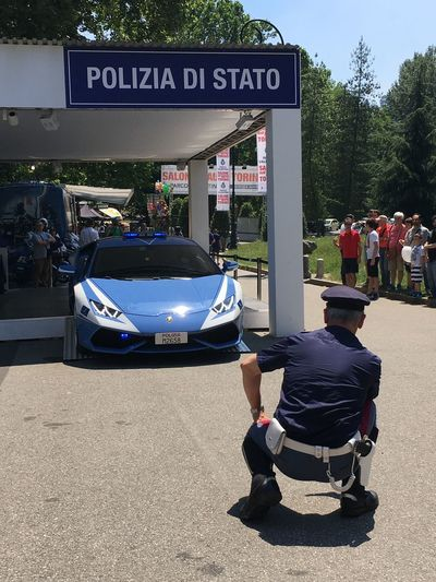 Polizia Transportation Car Text Land Vehicle Real People Mode Of Transport Tree Men Communication Day Lifestyles Motorcycle Full Length Outdoors Architecture One Person Sky Adult People Adults Only
