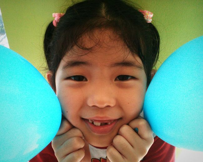 There was no model... So i just took a photo of my sister.... Kids Being Kids Girl ASIA Balloons🎈 Blue Green Green Green!  Blue Blue Blue Smile Smile ✌ Cute Pilipinas Smalleyes Eyem Cute People Whatever Shot Sister ❤ The Portraitist - 2016 EyeEm Awards 2016 EyeEm Awards The 2016 EyeEm Awards