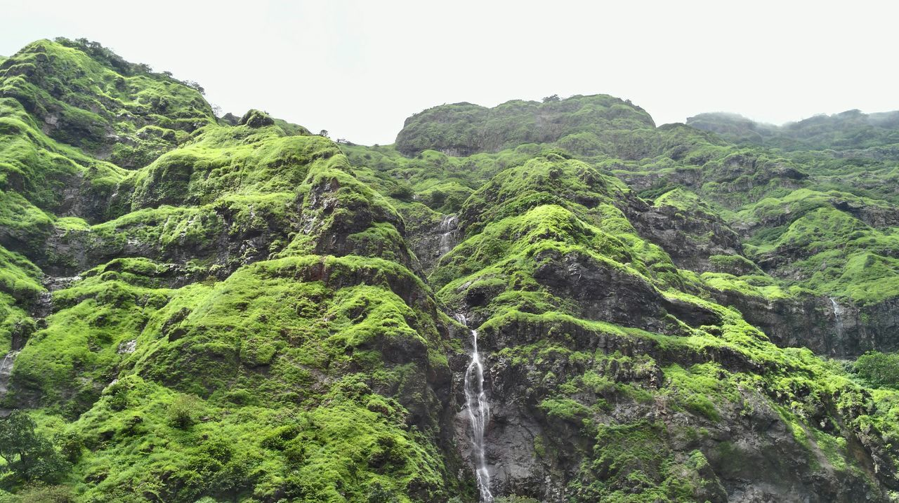Low Angle View Of Waterfalls Over Mountain