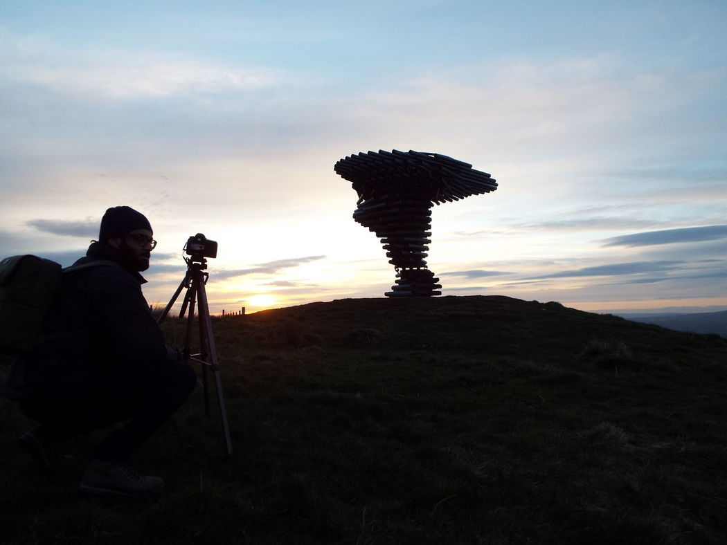 Silhouette of a photographer at the Singing Ringing Tree, Burnley Silhouette Pennine Moors Pennines Pennine Hills Silouette & Sky Sculpture Tubes Pipes Landmark Camera Tripod Photographer