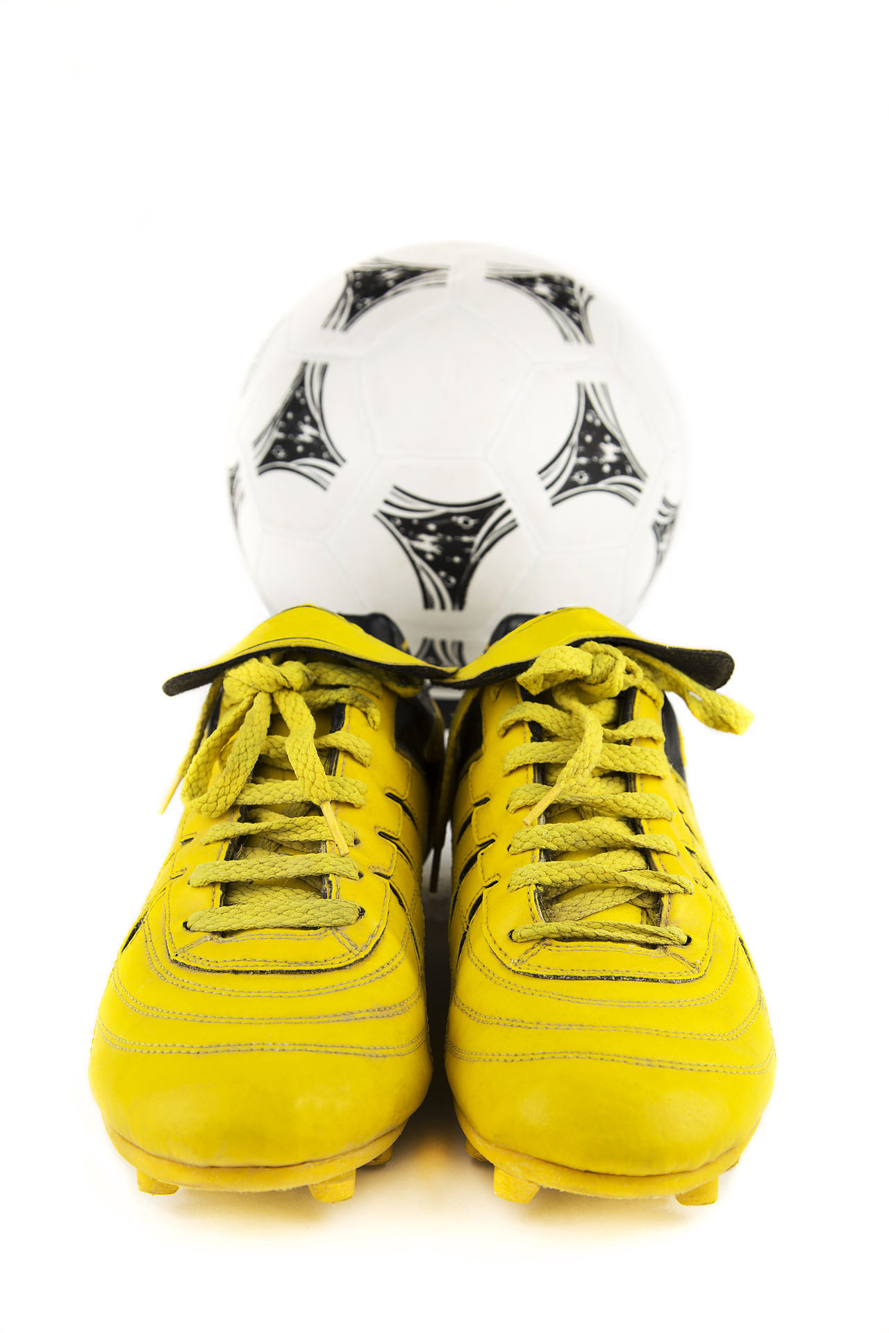 Team; B Black Background Close-up Colored Background Cut Out Football Gear Ideas No People Player Shoes; Soccer Still Life Studio Shot Two Objects White Background Yellow