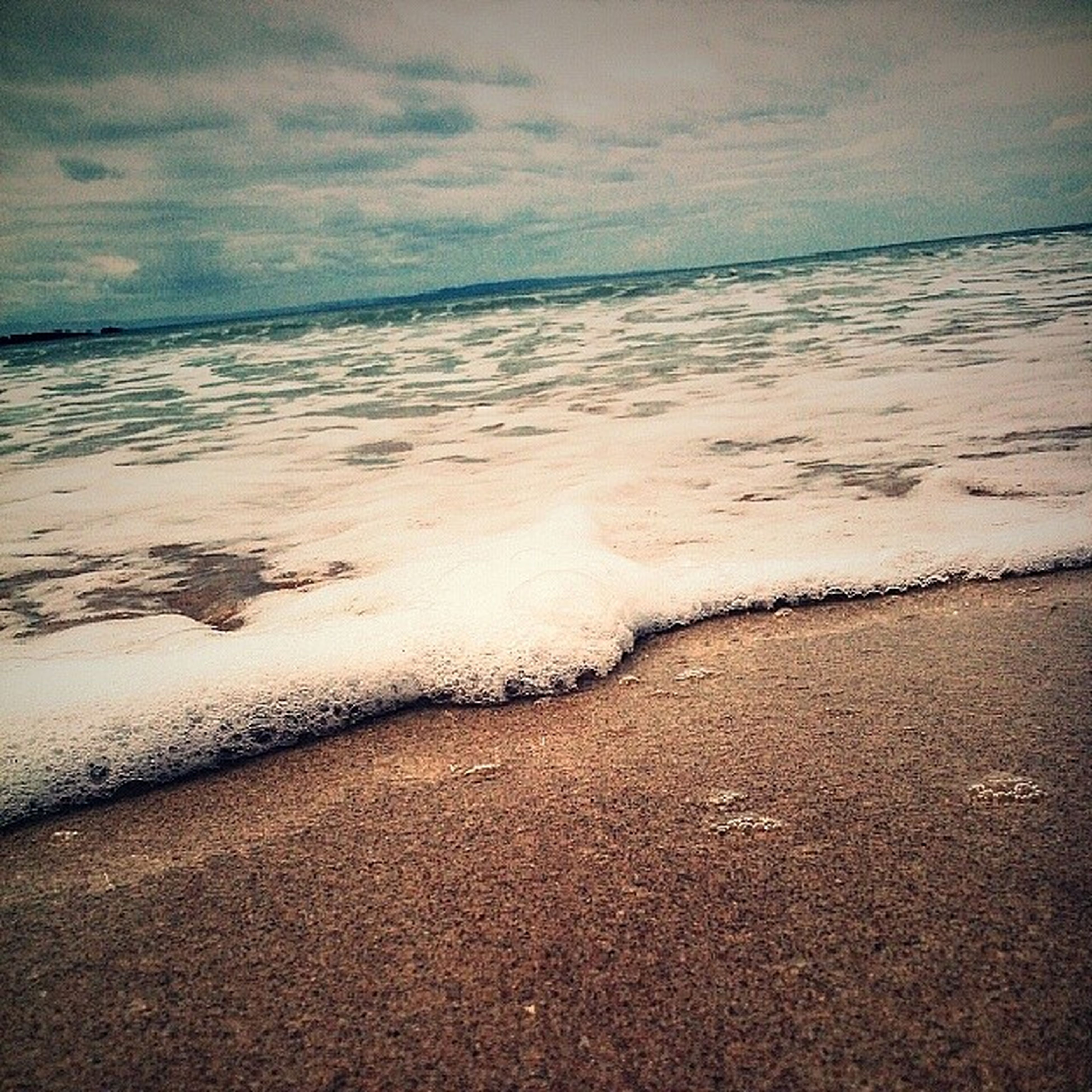beach, sea, water, sand, shore, horizon over water, wave, surf, sky, tranquility, tranquil scene, scenics, beauty in nature, nature, coastline, cloud - sky, idyllic, footprint, wet, outdoors