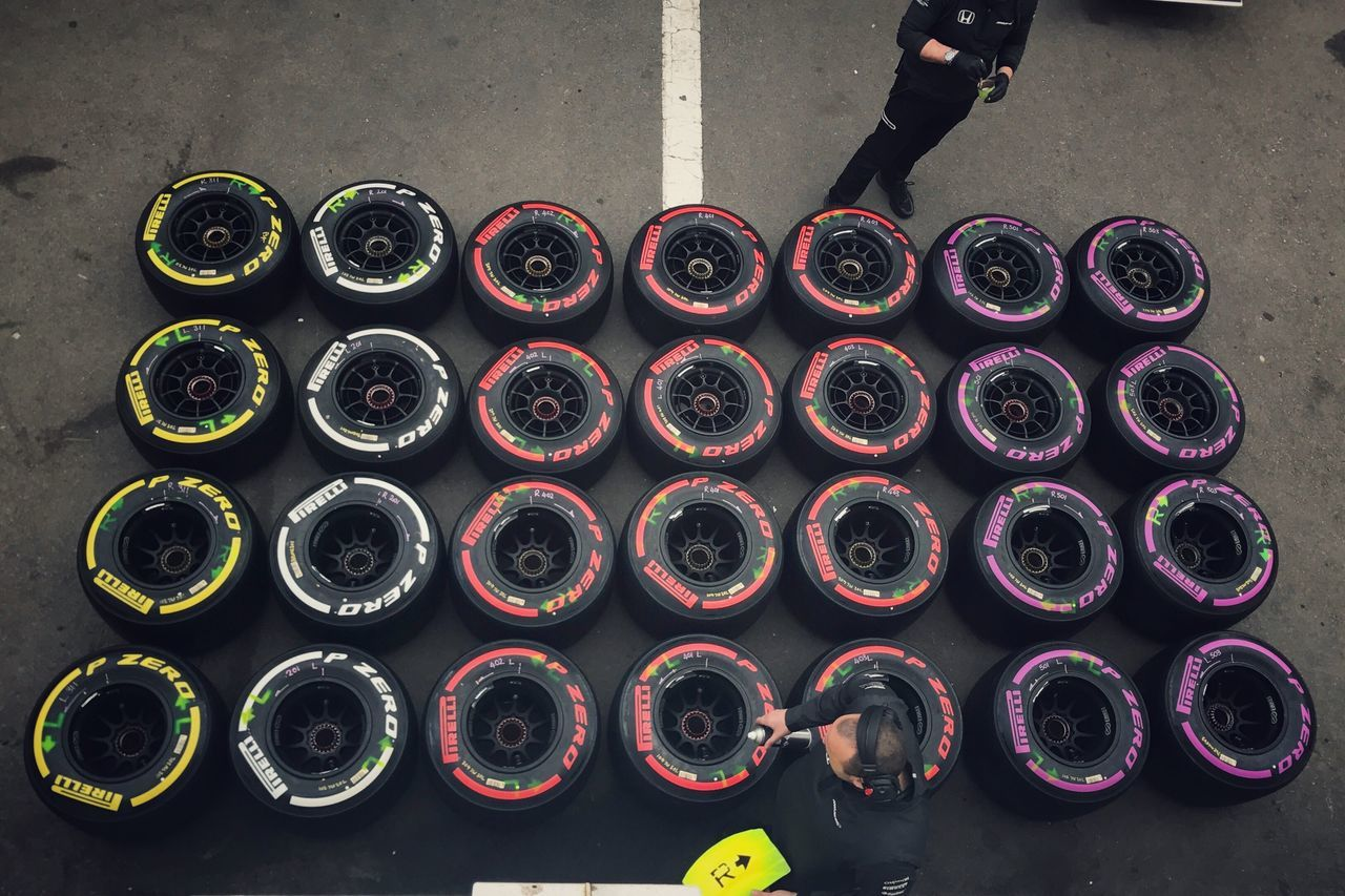 Formula 1 Large Group Of Objects In A Row Standing Men Outdoors Paint Can Human Hand Repetition Pirelli Tyre Tire McLaren Honda Barcelona SPAIN Catalunya Low Section Photography Working