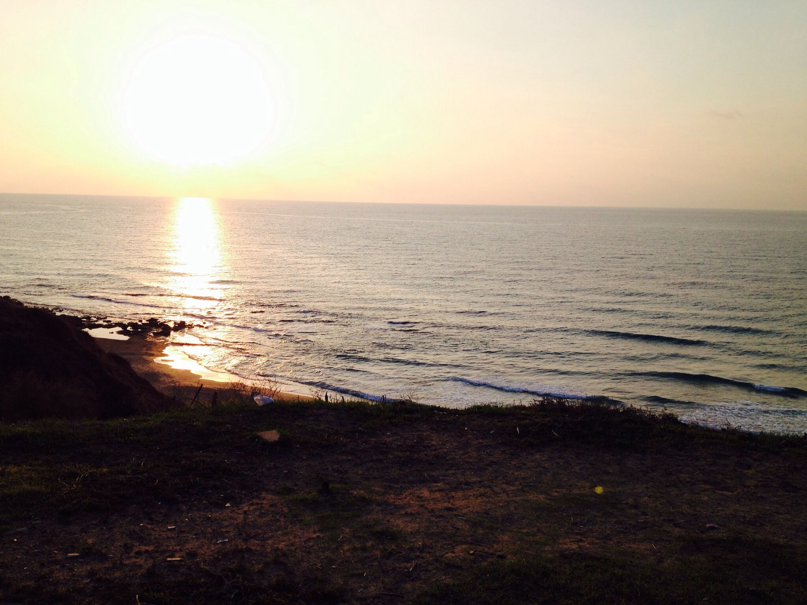sea, horizon over water, water, tranquil scene, sun, sunset, scenics, tranquility, beauty in nature, clear sky, nature, idyllic, beach, reflection, sky, shore, sunlight, seascape, rippled, copy space