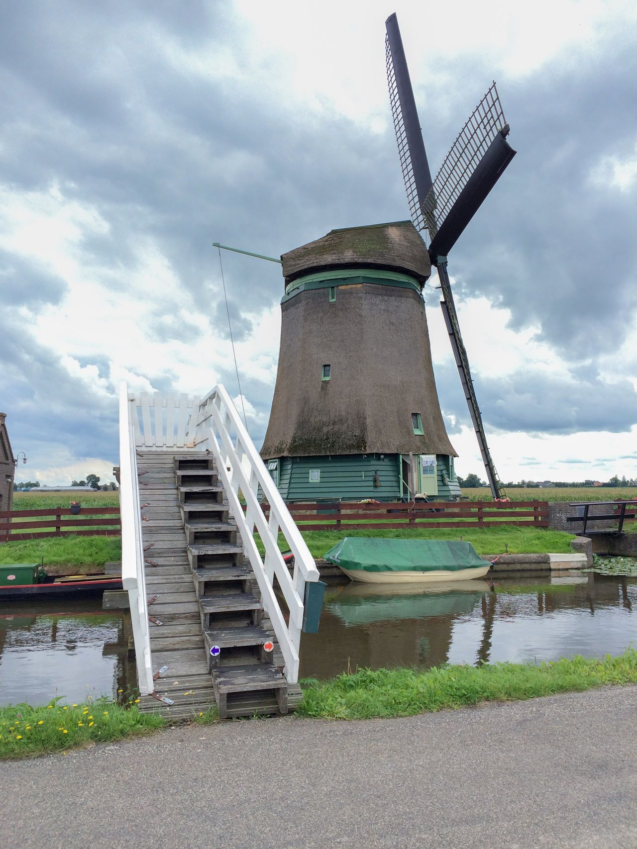 Traditionel windmill in Netherlands. Alternative Energy Architecture Boat, Fishing Boat, Paddle, Row, Row Boat, Vessel, Water Craft Ship, Cloud - Sky Day Holland Landscape, Seascape, Peggy's Cove, Peaceful Netherlands Opmeer Outdoors Renewable Energy Traditional Windmill Water Wind Power Windmill