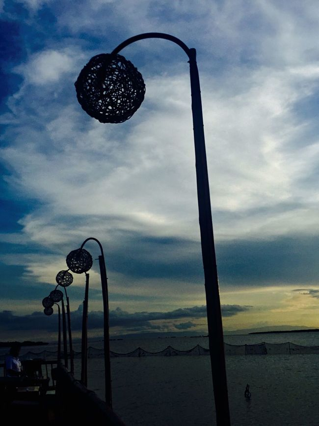 Street Light Dusk Lighting Equipment Cloud Sky Tranquility Tranquil Scene Cloud - Sky Lamp Post Scenics Outdoors Nature Cloudy Beauty In Nature No People Seascape Sea Restaurant Breeze Philippines Eyeem CDO Eyeem Philippines EyeEm EyeEm Best Shots EyeEm Nature Lover