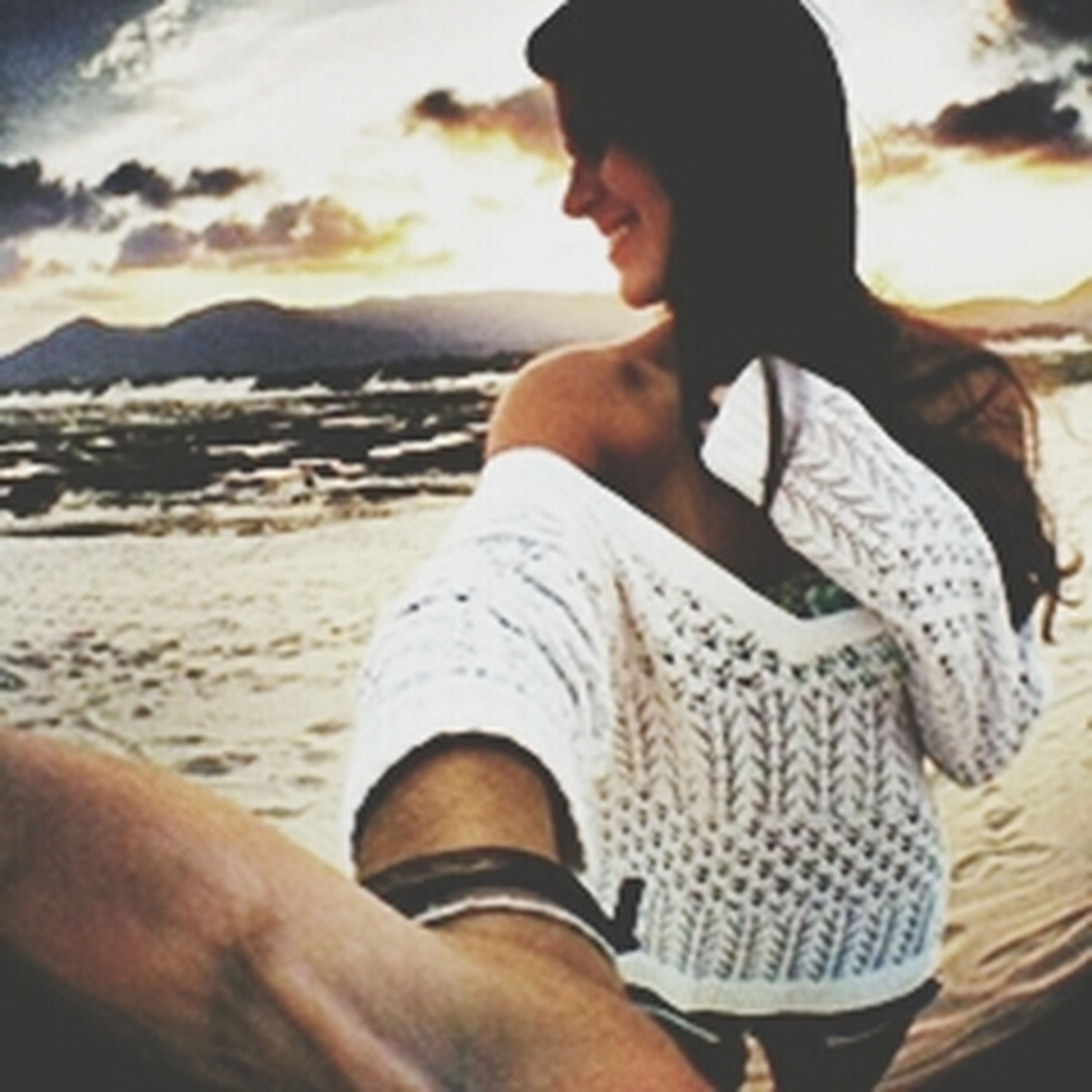 lifestyles, leisure activity, sunset, sky, beach, men, vacations, focus on foreground, relaxation, standing, casual clothing, sea, sitting, person, sunlight, young adult, outdoors, nature