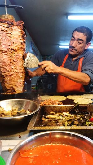 Taco Man Mexico Cutting Onions Vegetables Sauce Salsas Picantes Meat! Meat! Meat! Taco Stand Mexican Tacos Food Food And Drink Real People Freshness Indoors  Preparing Food Ready-to-eat One Person Meal Men Human Hand Chef Close-up People