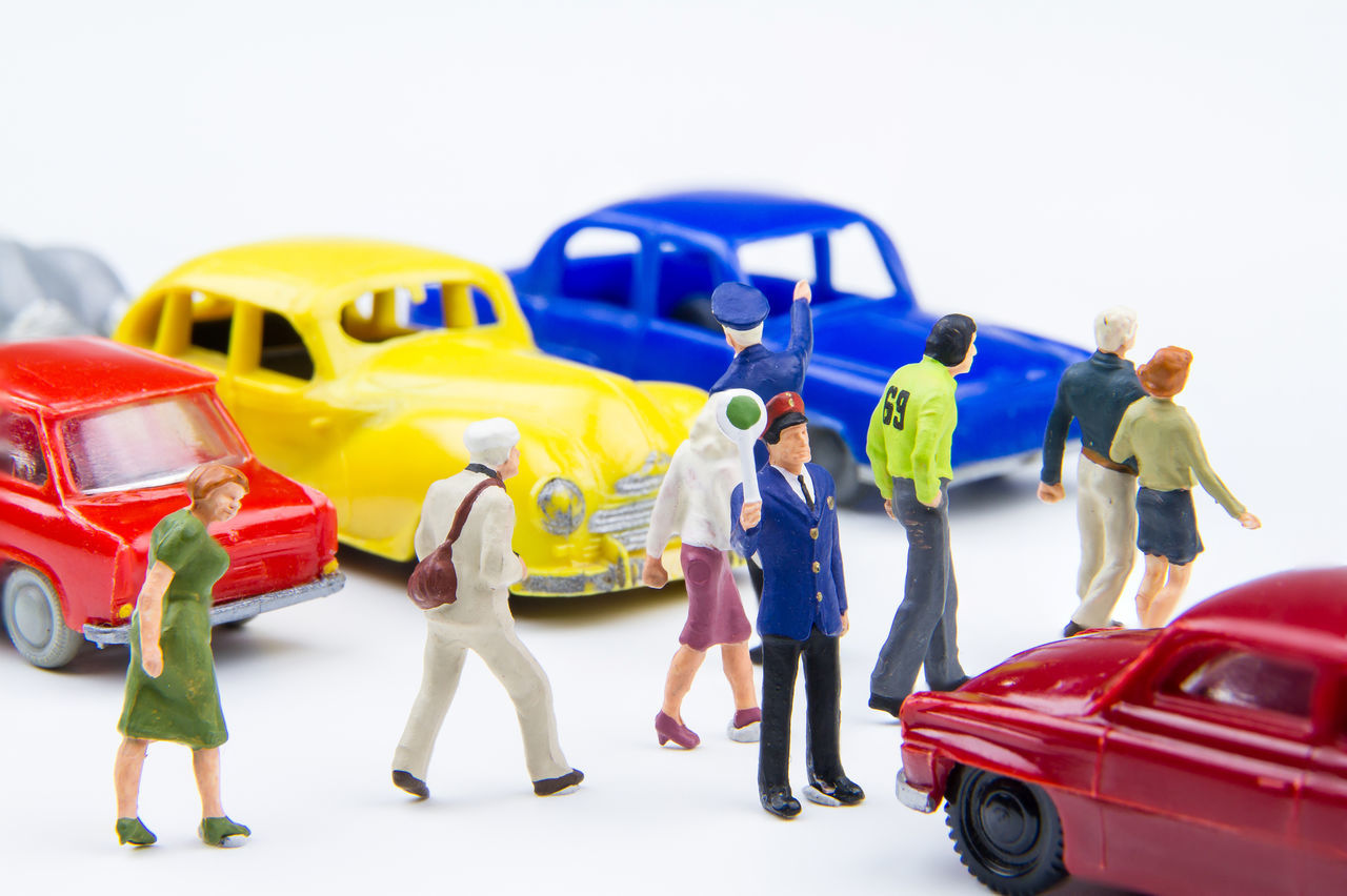Miniature tiny toys police are standing Do not driveway for people walking crossing the street. Busy Capital Car Cheerful City Crossroads Crosswalk Downtown Full Length Group Hurry Mode Of Transport Outdoors Pedestrian People Police Road Rush Stationary Street Toy Traffic Transportation Urban Walking