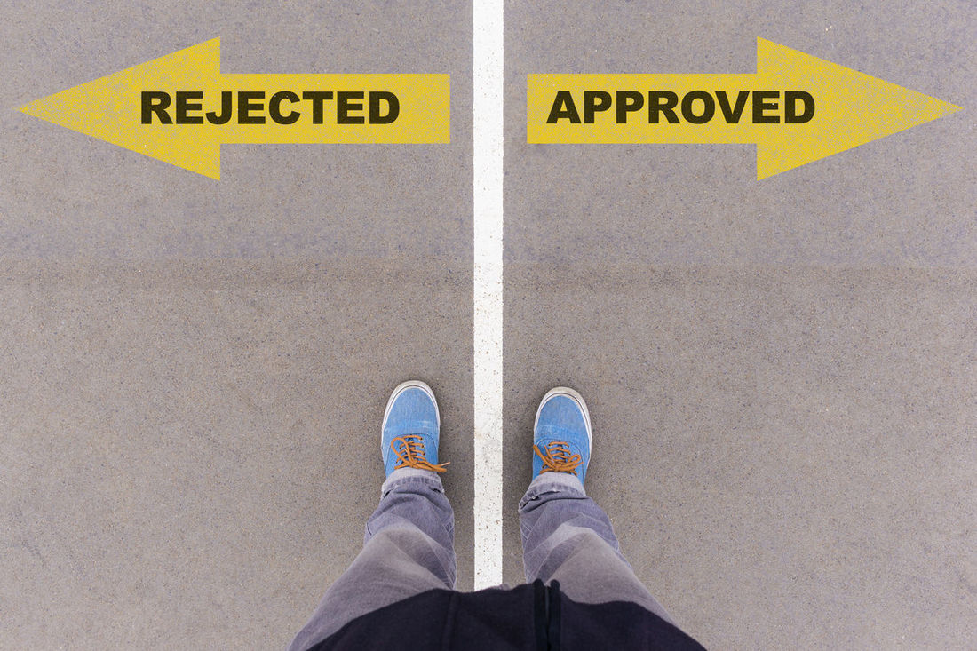 Rejected or approved Application Approval Approved Concept Day Directly Above High Angle View Human Body Part Human Leg Inspection Low Section Men One Person Outdoors People Personal Perspective Rejected Rejection Review Shoe Standing Symbol Test