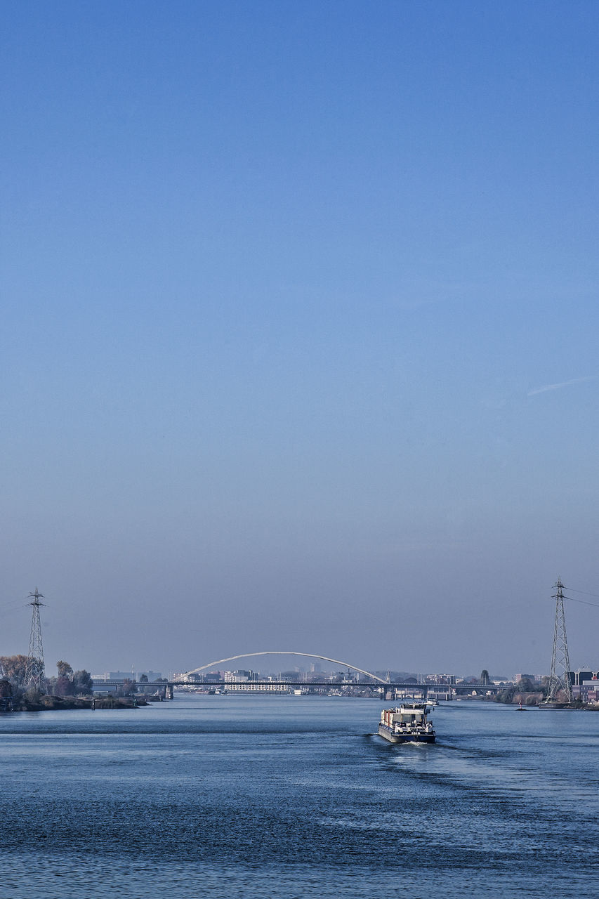 Cropped Boat In River Against Clear Blue Sky