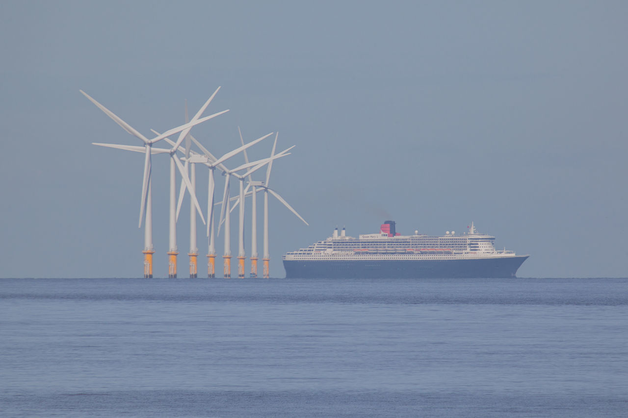 Cunard's Queen Mary 2 approaching Liverpool across Liverpool Bay Alternative Energy Boat Cruise Ship Cunard Environmental Conservation Liverpool Liverpool Bay Mersey Merseyside Ocean QM2 Queen Mary 2 Queen Mary II Renewable Energy River Sea Ship Telephoto Tranquil Scene Wind Farm Wind Power Zoom