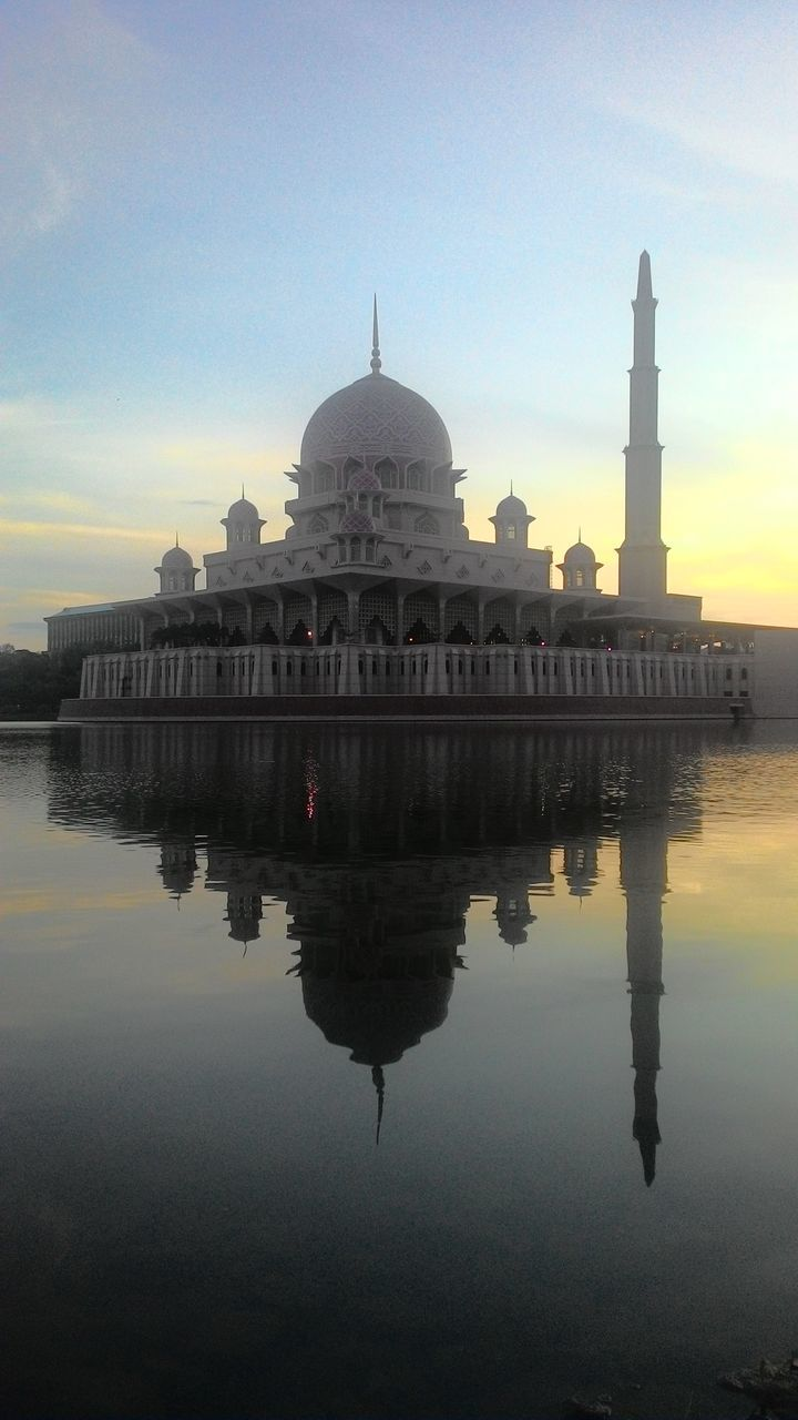 reflection, dome, architecture, built structure, religion, building exterior, travel destinations, water, place of worship, sky, spirituality, tourism, waterfront, travel, sunset, outdoors, lake, reflecting pool, no people, day