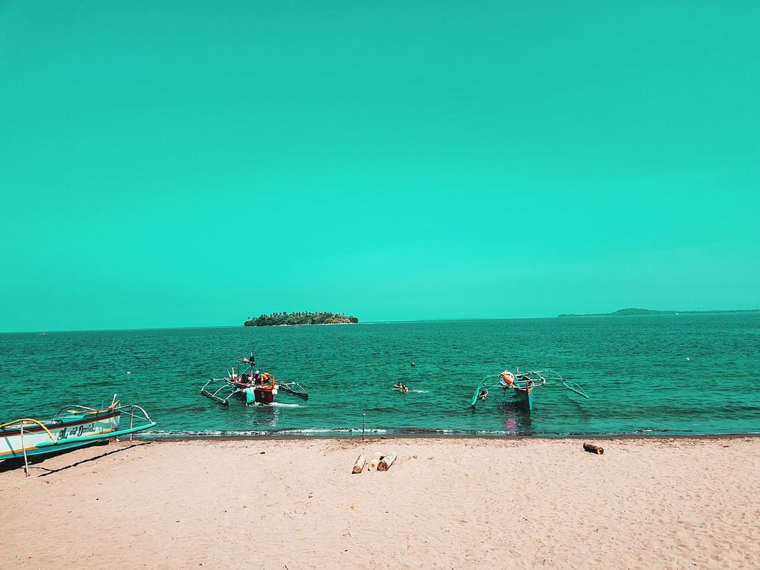 Unforgettable island. Beach Sand Sea Travel Photography Orange And Teal Potipot Philippines Large Group Of People Water Horizon Over Water Blue Vacations Outdoors People Adult Sky Nature Men Day Beauty In Nature Adults Only