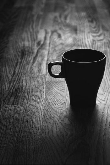 A cup of Coffee - Beverage Black Black And White Blackandwhite Close-up Coffee Coffee - Drink Coffee Cup Cup Cup Of Coffee Darkness And Light Exceptional Photographs Eye4photography  EyeEm Masterclass Pivotal Ideas Focus On Foreground Home Is Where The Art Is Illuminated Light And Shadow EyeEm Best Shots - Black + White Refreshment Selective Focus Still Life Table The Magic Mission