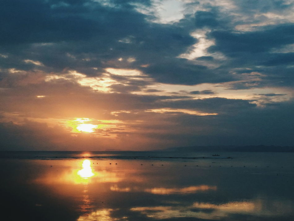 Reflection Sunset Reflection Cloud - Sky Dramatic Sky Scenics Nature Beauty In Nature Sea Tranquility Tranquil Scene Outdoors Sky Water Landscape Sun Beach Horizon Over Water No People Travel Destinations Ethereal