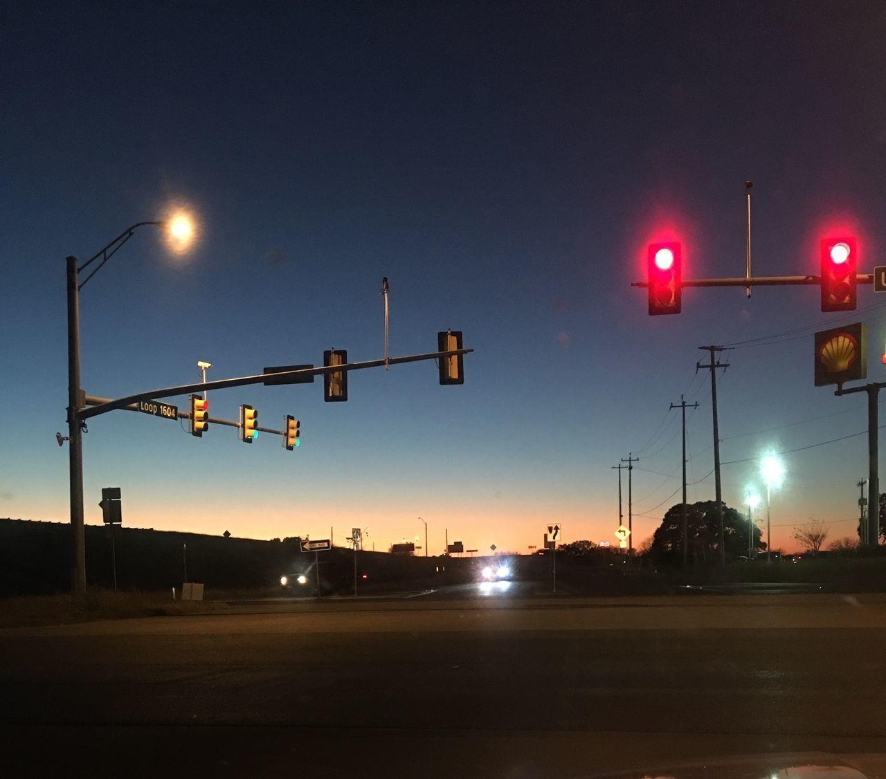 illuminated, night, transportation, red light, stoplight, guidance, lighting equipment, street light, safety, road, no people, outdoors, mode of transport, railway signal, road sign, land vehicle, sky