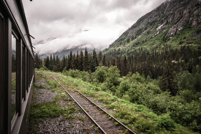 Beauty In Nature Cloud Cloud - Sky Cloudy Day Diminishing Perspective Landscape Mountain Mountain Range Nature No People Non-urban Scene On The Way Outdoors Public Transportation Rail Transportation Railroad Track Railway Track Scenics Sky The Way Forward Tranquil Scene Tranquility Tree Vanishing Point