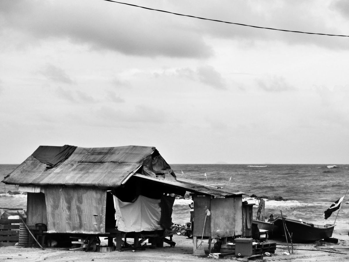Life at the beach Sea Beach Architecture Built Structure Sky Water Outdoors Day Building Exterior Horizon Over Water No People Nature Beauty In Nature Black And White Collection  Blackandwhite Photography Fisherman Fisherman Village Fisherman Cabins Black And White Malaysia Life at Terengganu