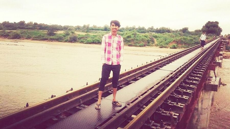 70sinhsodha One Person Railroad Track Transportation Standing Connection Full Length People Day One Man Only Adult Technology Sky Child Outdoors One Young Man Only Only Men Lifestyles Real People Young Adult Nature First Eyeem Photo