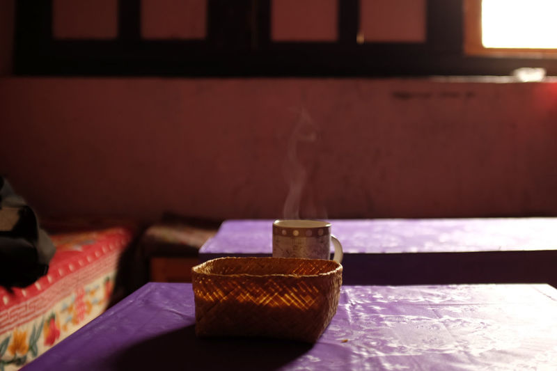 a warm drink and biscuits/shelter from a cold day in bhutan Backlight Backlit Bhutan Biscuits Bokeh Coffee Copy Space White Cup Focus On Foreground Fujifilm_xseries No People Refreshment Serenity Still Life Steaming Mug Midieval House Back Lit Hot Drink Table Cloth Purple Food And Drink Coffe At Home Tea Time Getting Inspired Coming Home Place Of Heart