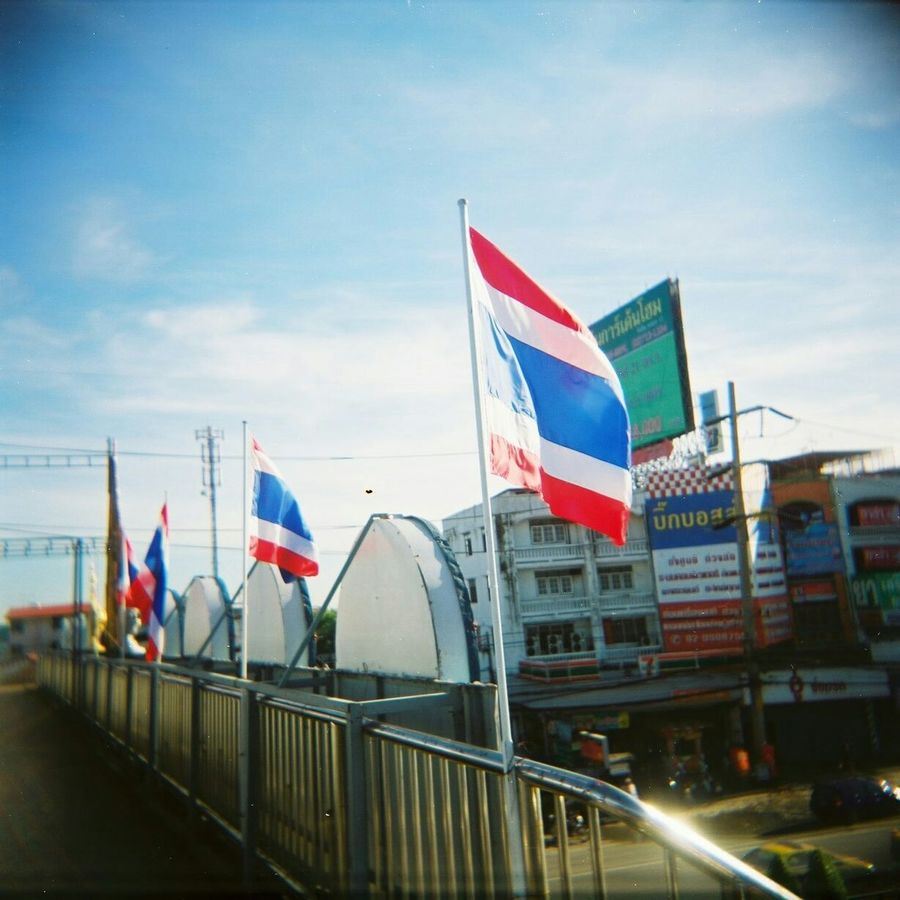I Love My City Capturing Movement Flag Flags In The Wind  I Love Thailand The Purist (no Edit, No Filter) Streetphotography Untold Stories On The Bridge Try Something Different Film Film Photography Filmisnotdead Filmcamera Cityscapes Motion Capture Looking Around Still Life Love Is In The Air Taking Photos Snapshot Blue Sky Beautiful Sky