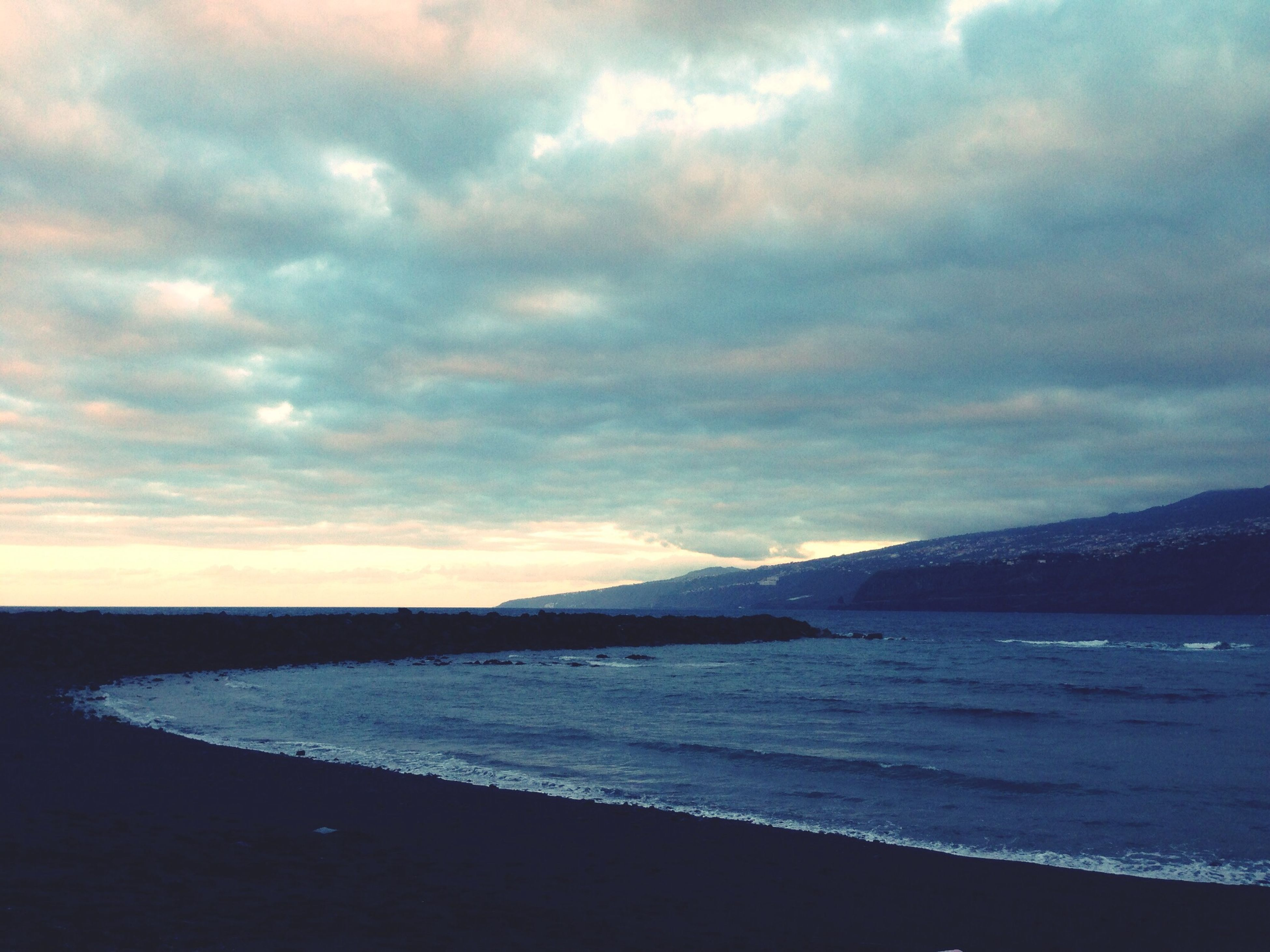 sea, water, sky, scenics, tranquil scene, tranquility, beauty in nature, cloud - sky, beach, cloudy, mountain, nature, shore, cloud, idyllic, horizon over water, coastline, dusk, sunset, weather