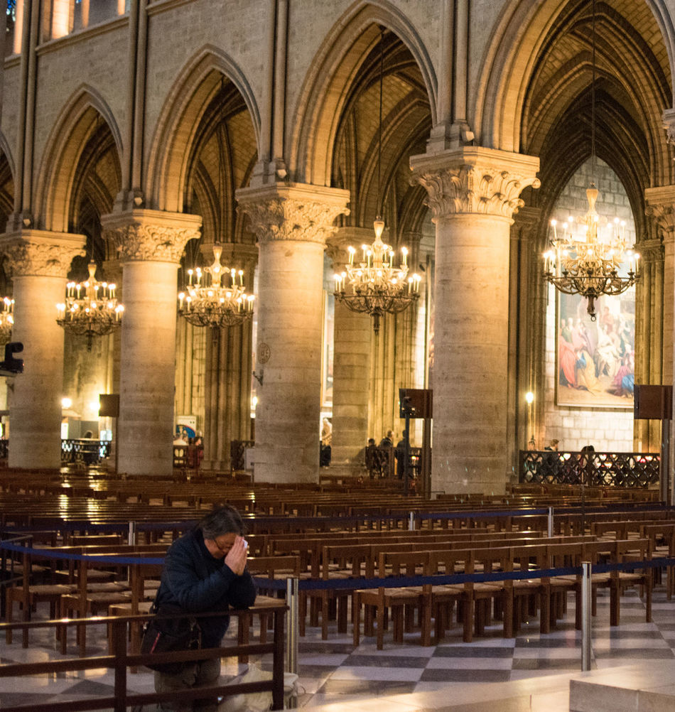Notre-Dame de Paris Adult Architecture Check This Out Day Eye For Photography Eye4photography  EyeEm Best Shots EyeEm Gallery EyeEmBestPics Full Length Hello World Illuminated Indoors  One Man Only One Person People Place Of Worship Real People Religion Side View Sitting Spirituality