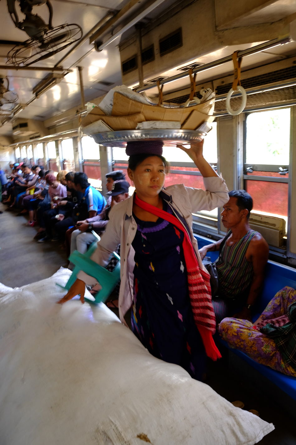 Woman Selling on the Yangon Circular Train Built Structure City City Life City Lifestyle Composition Full Frame Indoor Photography Large Group Of People Making A Living Myanmar Occupation Portrait Of A Woman Railway Carriage Real People Selling Standing Traditional Clothing Traditional Culture Travel Destination Woman Woman Portrait Working Yangon Yangon Circular Railway Yangon Circular Train