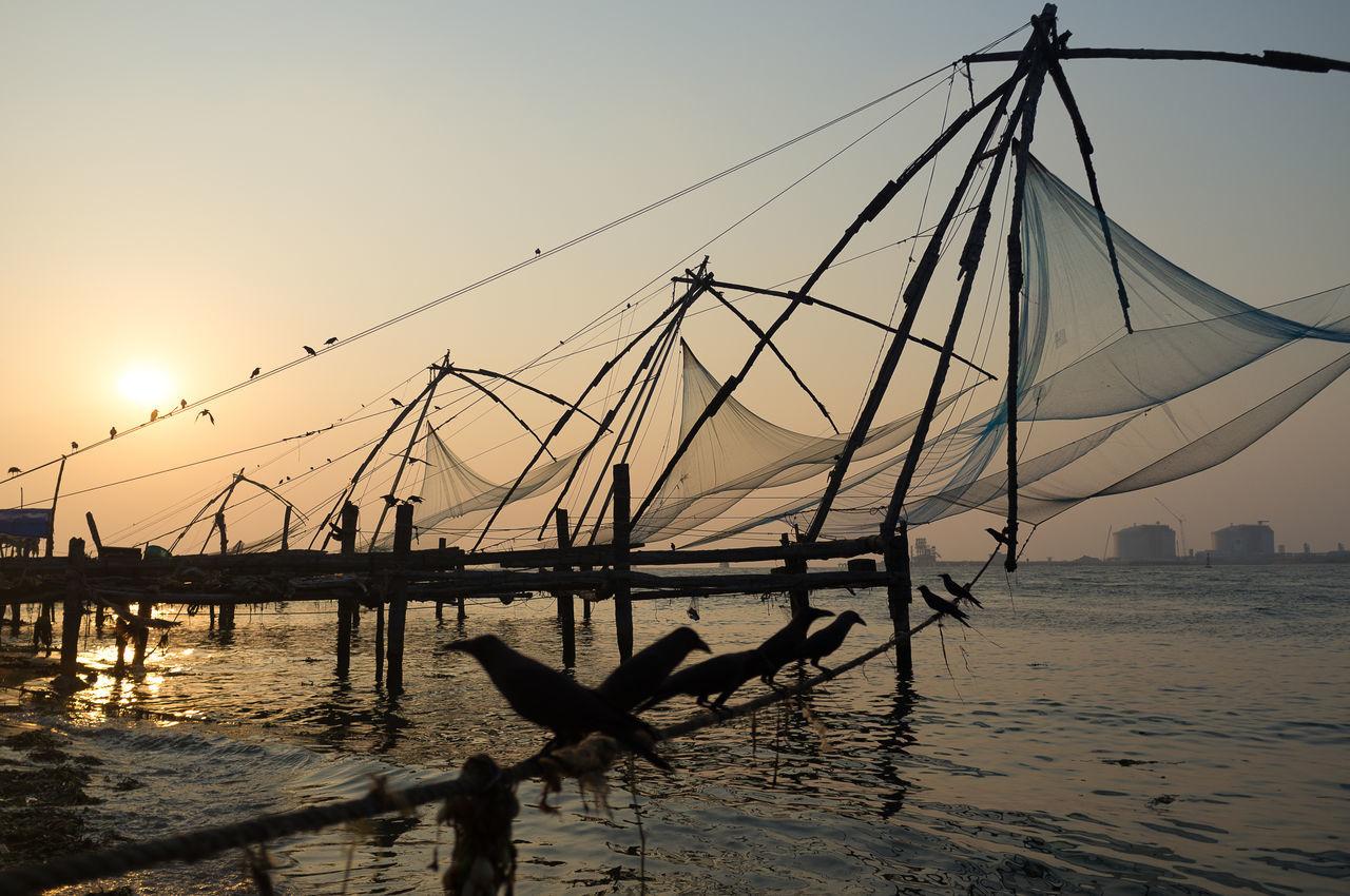 Chinese fishing nets at sunset in Kochi, India Beach Birds Fishing Kerala Kochi Nature Outdoors Scenics Sea Silhouette Sky Sunset Water