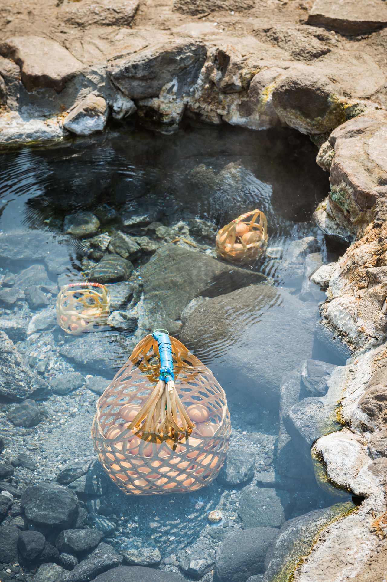 Boil egg in hot springs Basket Black Boiled Eggs Create Day Egg Food And Drink Gray Healthy Eating Healthy Food High Angle View Hot Hot Springs Natural Nature No People Object Onsen Onsen Egg Outdoors Pond Stone Transparent Travel Water