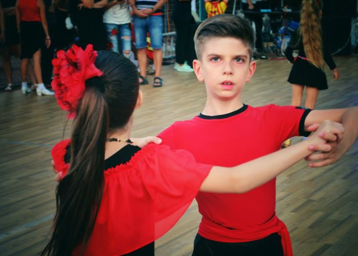 Two People Portrait Child Friendship Togetherness Red Boys And Girls Sport Competition Healthy Lifestyle Ballroom Dancing Dance Dancing Motion Leisure Activity Music Coach Dancer Real People Dance Floor Spanish Style