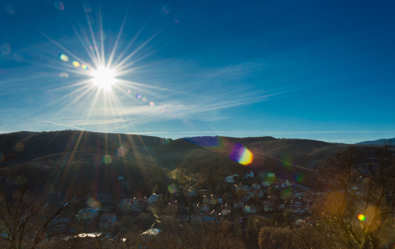 lens flare, sun, sunlight, sunbeam, nature, beauty in nature, scenics, outdoors, tranquility, no people, blue, sky, landscape, day, mountain