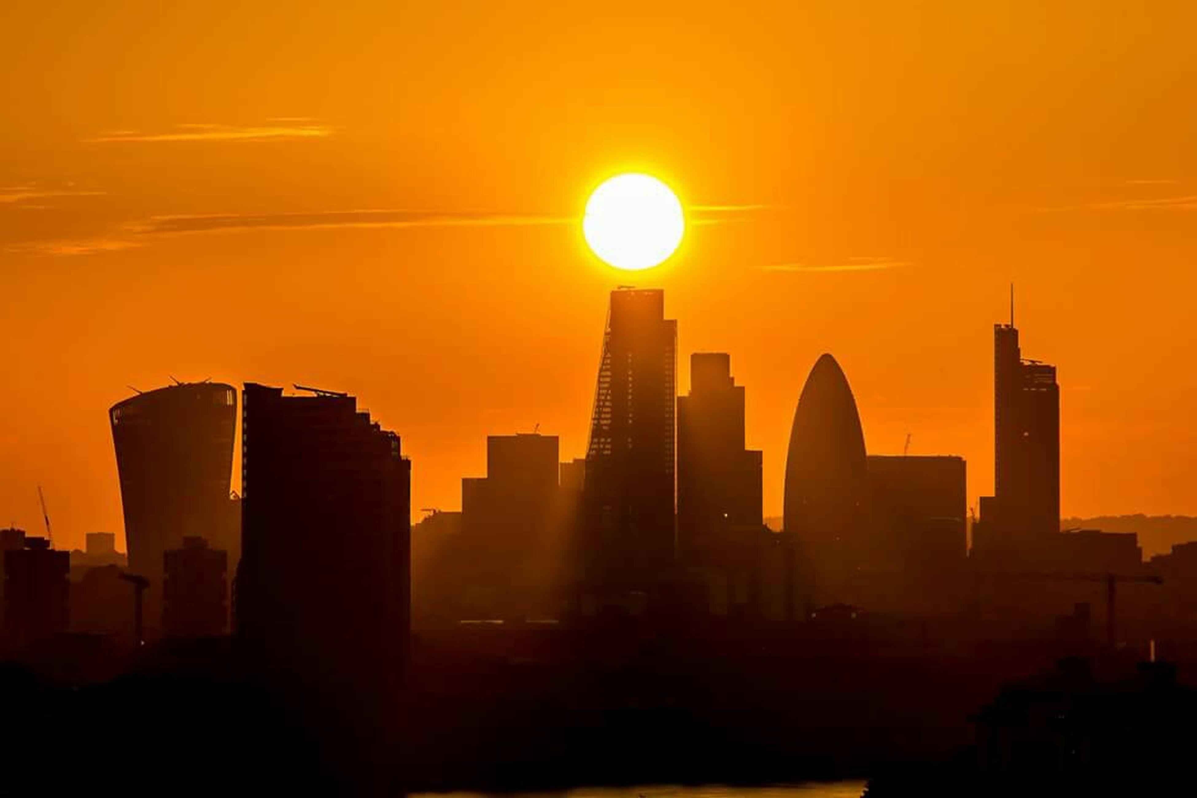 sunset, architecture, building exterior, built structure, silhouette, city, skyscraper, orange color, sun, cityscape, sky, urban skyline, building, office building, modern, tower, tall - high, dark, skyline, outdoors