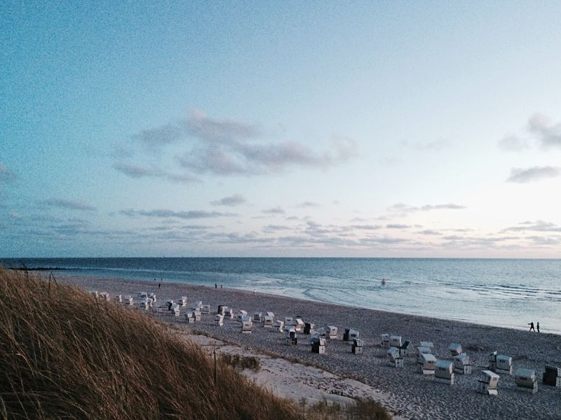 Sea Sky Beach Nature Beauty In Nature Cloud - Sky Outdoors Horizon Over Water Water Blue Scenics No People Landscape Sunset Day Beach Chairs North Sea