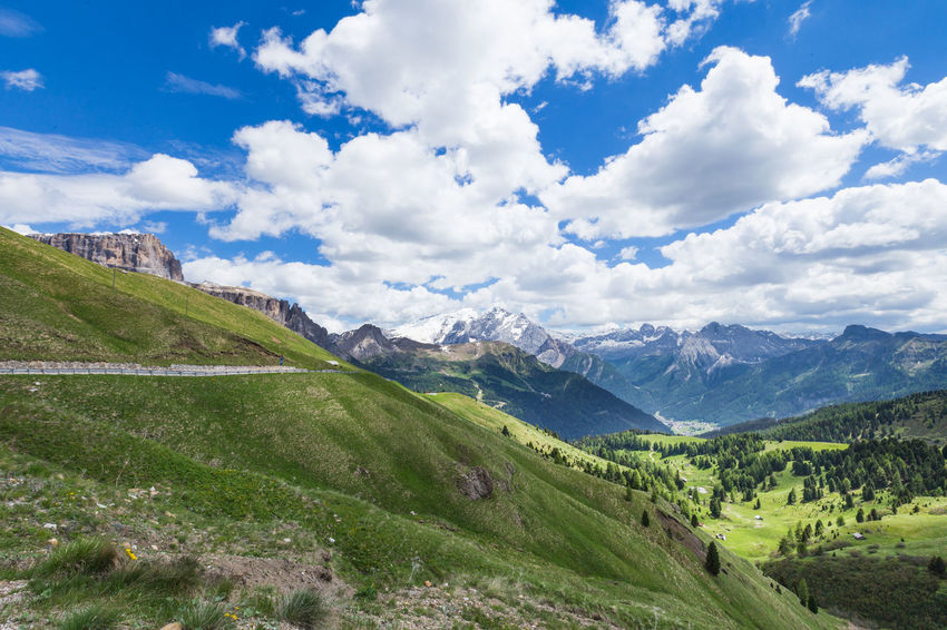 Far view in the Dolomites on the Sella Ronda in Italy Blue Sky White Clouds Dolomites, Italy Beauty In Nature Day Grass Landscape Mountain Mountain Range Nature No People Outdoors Range Scenics Sky Tranquil Scene Tranquility