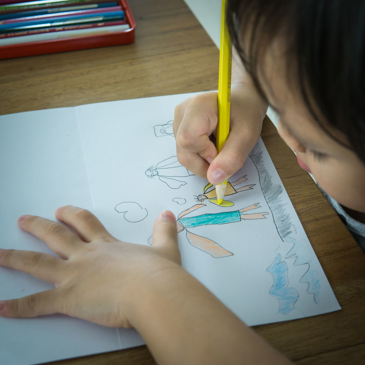 kid drawing her family picture Child Childhood Classroom Color Pencils  Drawing - Activity Education Family Girls Indoors  Learning Leisure Activity Lifestyles One Person Paper Pencil Real People Sketch Table Writing