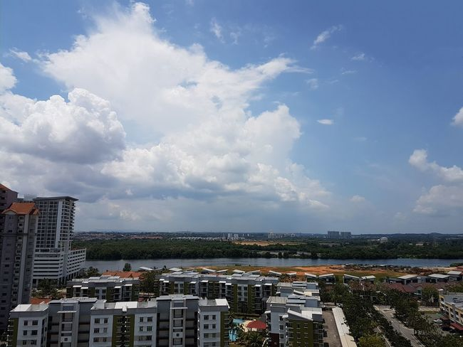 Architecture City Building Exterior Built Structure Cityscape Sky Skyscraper Tall - High Cloud - Sky Water Tower Development Growth Urban Skyline City Life Blue Building Story Modern River View River Aerial View Day Office Building Travel Destinations Johor Bahru