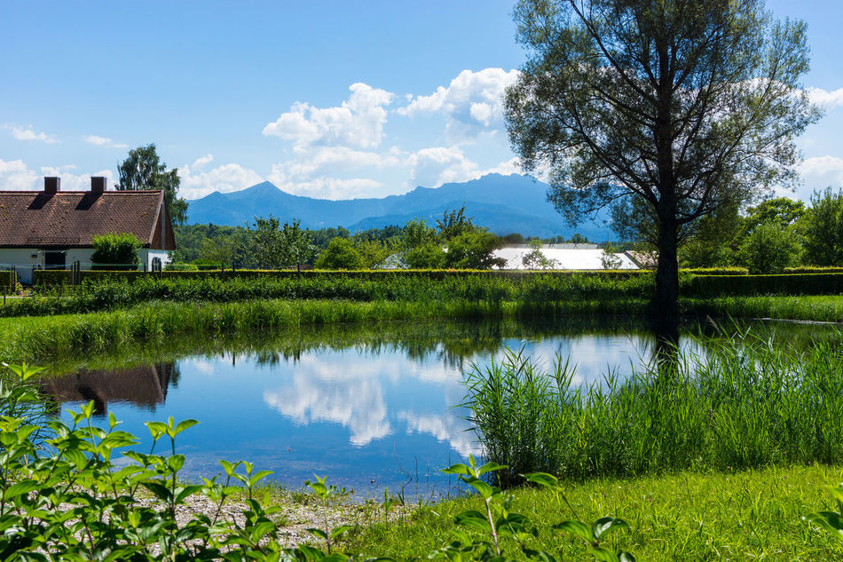 Small lake Architecture Beauty In Nature Building Exterior Built Structure Day Grass Green Color Lake Mountain Nature No People Outdoors Plant Reflection Scenics Sky Tranquil Scene Tranquility Tree Water